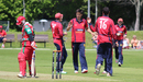 Ben Stevens is congratulated after taking the wicket of Zeeshan Siddiqui, Jersey v Oman, ICC World Cricket League Division Five, St Saviour, May 23, 2016