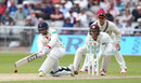 Alviro Petersen gets down low to sweep, Lancashire v Surrey, County Championship, Division One, Old Trafford, 2nd day, May 23, 3016