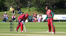 Munis Ansari yorks Peter Gough for the first of his five wickets, Jersey v Oman, ICC World Cricket League Division Five, St Saviour, May 23, 2016