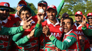 Munis Ansari is the center of the victory celebrations after taking career-best figures of 5 for 27, Jersey v Oman, ICC World Cricket League Division Five, St Saviour, May 23, 2016