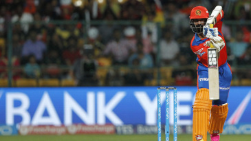 Dinesh Karthik pushes one towards long-off