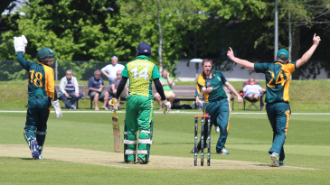 Max Ellis celebrates his third wicket with another catch at slip by Thomas Kirk (24)