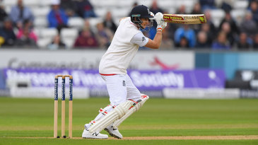 Joe Root drives through the covers