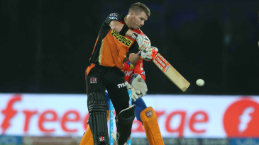 David Warner stands tall for a cut