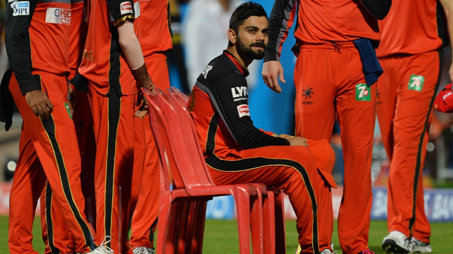 A pensive Virat Kohli waits for his team to gather around for a team photo ahead of the game