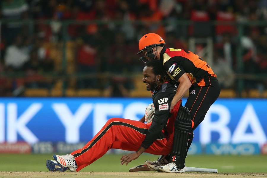 Chris Gayle shelled a difficult return catch from Shikhar Dhawan in the second over, but still found a reason to smile as Warner helped him back on his feet