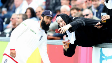 Moeen Ali poses for a selfie with a spectator