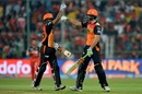 Ben Cutting and Bhuvneshwar Kumar punch gloves after taking their side to 208, Royal Challengers Bangalore v Sunrisers Hyderabad, IPL 2016, final, Bangalore, May 29, 2016
