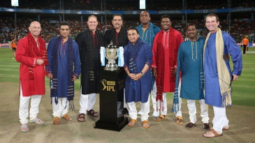 The commentary team for the final poses with the IPL trophy