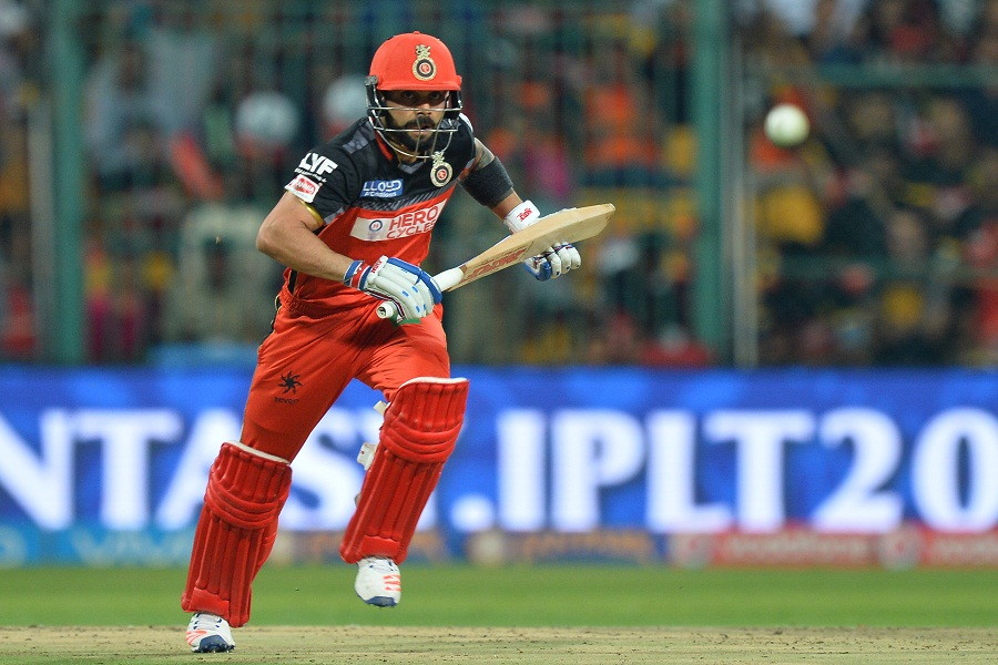 Kohli was more sedate as Royal Challengers reached 100 for no loss in nine overs