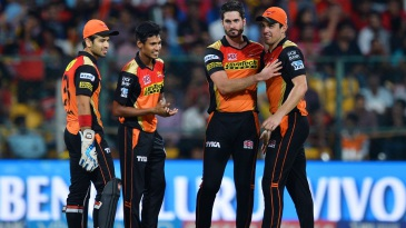 Naman Ojha, Mustafizur Rahman, Ben Cutting and Moises Henriques celebrate a wicket