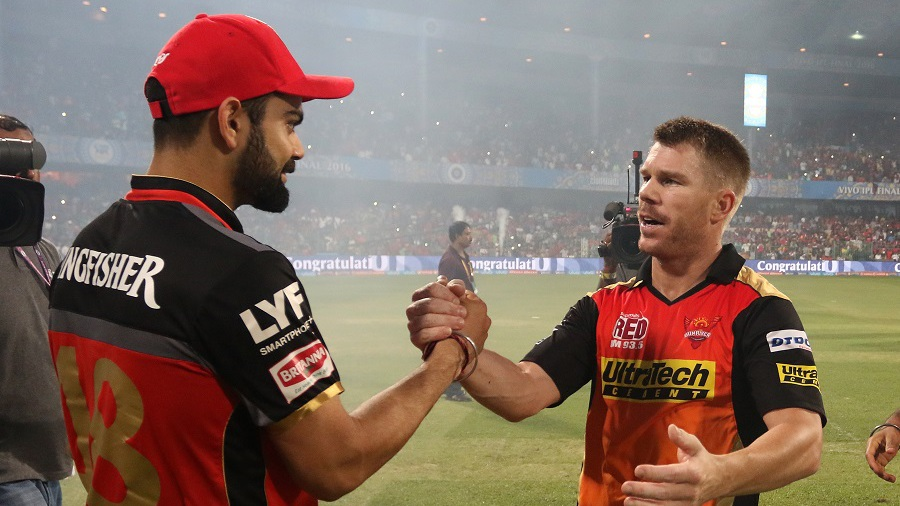 Virat Kohli and David Warner greet each other after the match