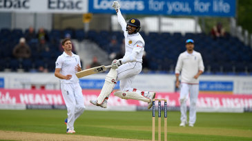 Jumping for joy: Dinesh Chandimal goes to his sixth Test hundred