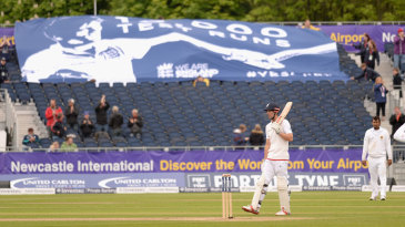 A banner in the crowd was unfurled to acknowledge Alastair Cook reaching 10,000 Test runs