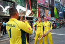 Usman Khawaja takes a photo of his team-mates Adam Zampa and Steven Smith, New York, May 28, 2016