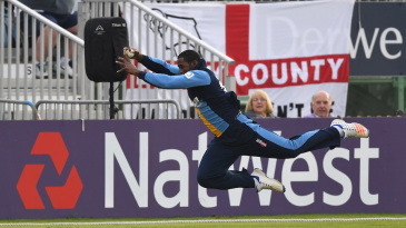 Chesney Hughes dives full-length for a catch