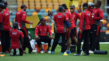 UAE coach Aaqib Javed takes a break with his side during a training session