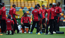 UAE coach Aaqib Javed takes a break with his side during a training session, World Cup 2015, Brisbane, February 24, 2015