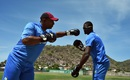 Put 'em up: West Indies coach Phil Simmons boxes with captain Jason Holder, Basseterre, June 10, 2016