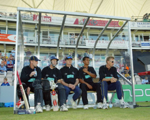 Hampshire players John Crawley, Simon Katich, Shaun Udal, Lawrence Prittipaul and Alan Mullally wait in the dugout during the Twenty20 Cup match between Hampshire and Sussex, Southampton, June 13, 2003