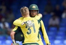David Warner is embraced by Usman Khawaja, Australia v South Africa, 4th match, ODI tri-series, St Kitts