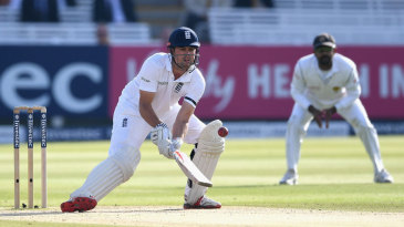 Concentrate, concentrate: Alastair Cook attempts to scoop