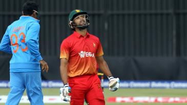 A disappointed Sikandar Raza walks back