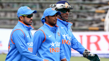 Karun Nair, Ambati Rayudu and MS Dhoni walk off after Zimbabwe's innings