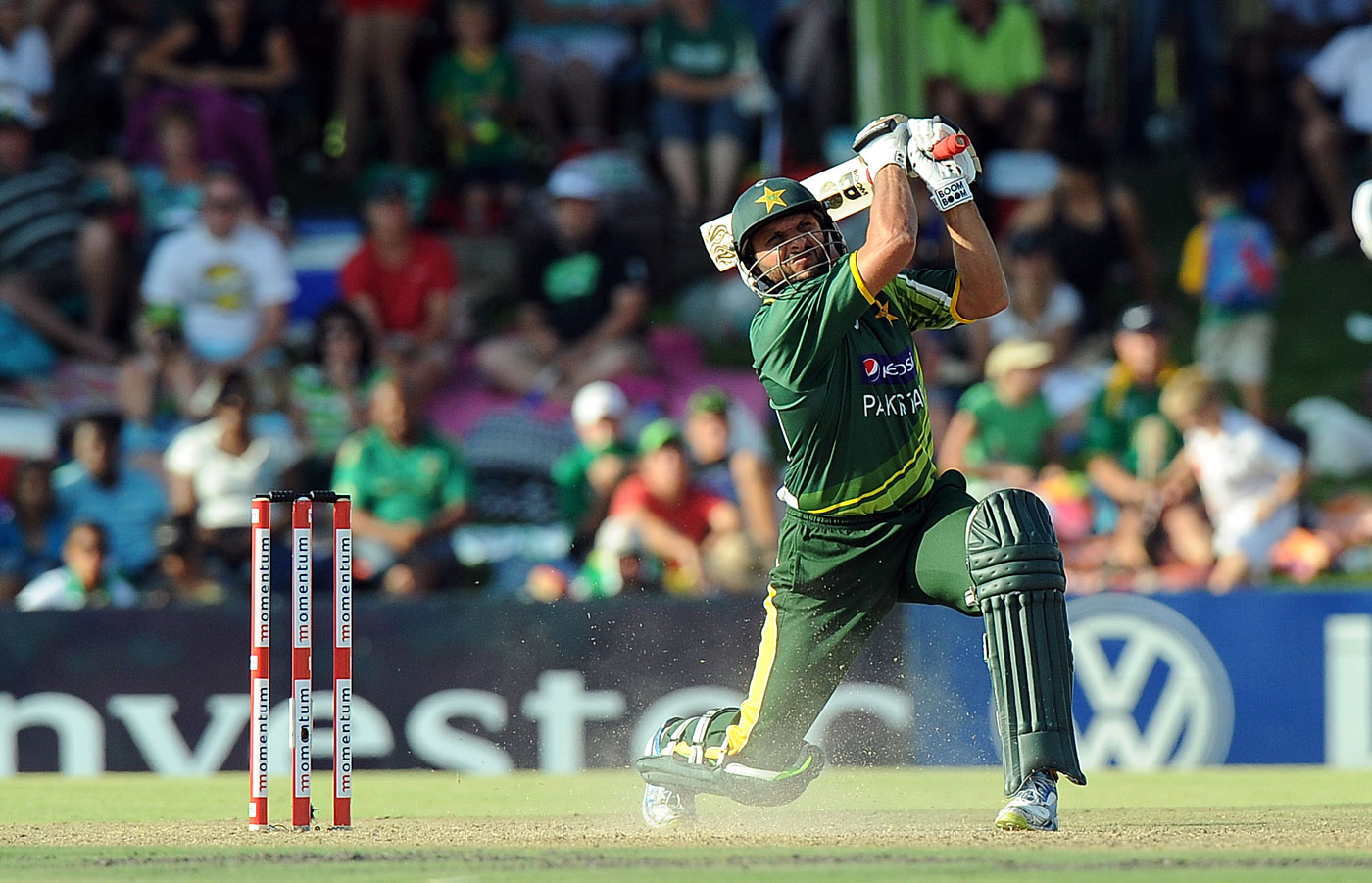 Shahid Afridi tries to clear the ground with a massive hit