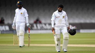 Kaushal Silva trudges back after falling lbw for 16