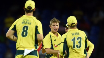 Adam Zampa is mobbed by his team-mates