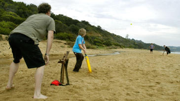Locals play a game of cricket on Monnah Beach South