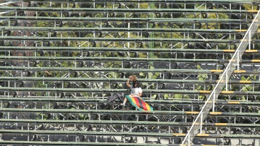 In the spotlight: A lone Zimbabwe fan takes cover from the sun
