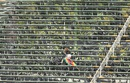 In the spotlight: A lone Zimbabwe fan takes cover from the sun , Zimbabwe v India, Harare, June 15, 2016