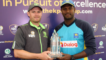 William Porterfield and Angelo Mathews pose with the series trophy