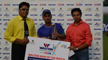 Pawan Negi poses with his Man of the Match award