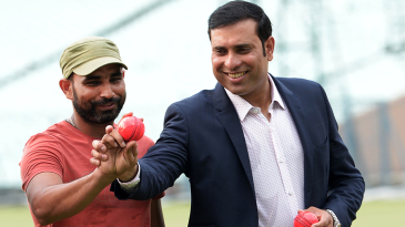 Mohammed Shami and VVS Laxman pose for the cameras before a pink-ball event