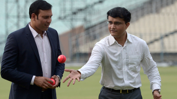VVS Laxman and Sourav Ganguly gesture at an event for pink-ball cricket