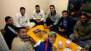 Pakistani pros in England league cricket sit down for a meal. From front (clockwise): Jalat Khan, Asif Raza, Nayyer Abbas, Sadaf Hussain, Nasir Malik, Usman Salahuddin, Bilawal Bhatti and Khalid Malik