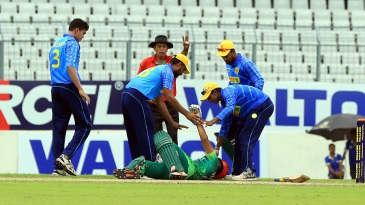 Suhrawadi Shuvo is attended to after being struck by a bouncer