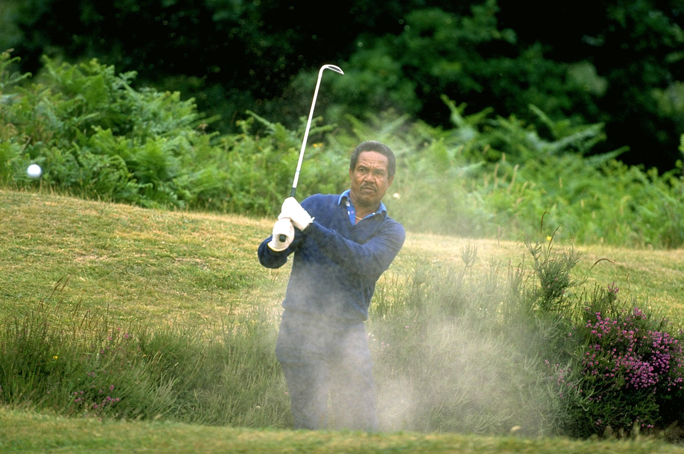 Garry Sobers plays golf