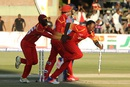 Catch me if you can: Neville Madziva takes off for a celebratory run after sealing Zimbabwe's win, Zimbabwe v India, 1st T20I, Harare, June 18, 2016