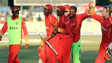 Makhaya Ntini rejoices with the Zimbabwe players