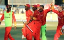 Coach Makhaya Ntini rejoices with the Zimbabwe players, Zimbabwe v India, 1st T20I, Harare, June 18, 2016