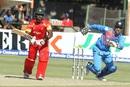 Elton Chigumbura works the ball into the leg side, Zimbabwe v India, 1st T20I, Harare, June 18, 2016