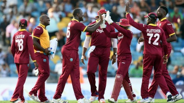 Carlos Brathwaite is mobbed by his team-mates
