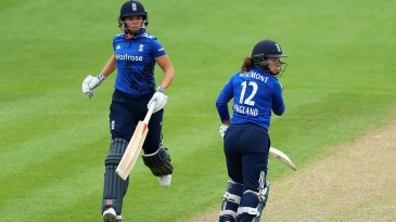 Tammy Beaumont and Lauren Winfield complete a run during their strong opening stand