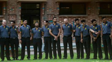 Pakistan players and coach Mickey Arthur line up for photographs ahead of the team's departure for England