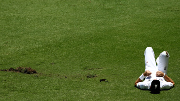 James Anderson lies on the field