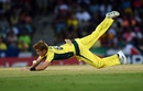 Zampa dives to his left to field the ball, West Indies v Australia, tri-series final, Barbados